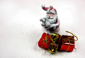 Christmas decoration snowy figure of santa claus and three gift holding in his arms a little lamb decorative gifts horizontal view Royalty Free Stock Photography