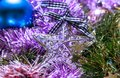 Christmas decoration, star on colorful garlands. Royalty Free Stock Photo