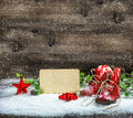 Christmas decoration stars antique baby shoes falling snow Royalty Free Stock Photo