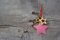 Christmas decoration stars hanging on wooden background top view of red checked Stock Photography