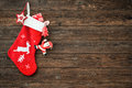 Christmas decoration stocking and toys hanging over rustic wooden background Stock Images