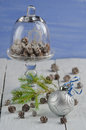 Christmas decoration with three cones and ball on old wooden table Royalty Free Stock Photo
