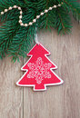 Christmas decoration toy and evergreen branch on a wooden background Stock Photos
