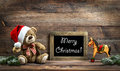 Christmas decoration toys teddy bear and rocking horse Royalty Free Stock Photo