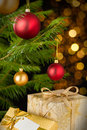 Christmas decoration tree baubles and gifts on shining lights background Stock Photography