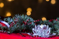 Christmas decoration with twig of fir and candle candlestick against defocused lights Royalty Free Stock Photography