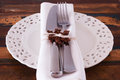 Christmas decoration white plate serviette fork knife with hand handmade brown crochet snowflake selective focus Stock Photography