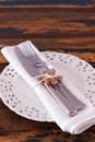 Christmas decoration white plate serviette fork knife with hand handmade brown crochet snowflake selective focus copy space Royalty Free Stock Photos
