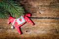 Christmas decoration on wood cred horse and pine branch with copy space Stock Image