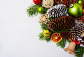 Christmas decoration with wooden jingle bell and straw ornaments Royalty Free Stock Photo