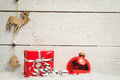 Christmas decorations against wooden wall Royalty Free Stock Photo
