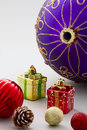 Christmas decorations balls gift boxes and pinecone Stock Image