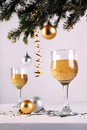 Christmas decorations with beverage wineglass and xmas ball on the table Royalty Free Stock Image
