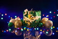 Christmas decorations bulb and lights with gift on dark background Royalty Free Stock Photos