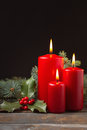 Christmas decorations candles with evergreen Royalty Free Stock Images