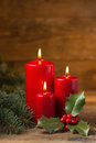 Christmas decorations candles with evergreen Stock Photos