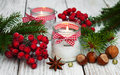 Christmas decorations candles in glass jars with fir Royalty Free Stock Photo