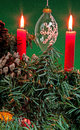 Christmas decorations and candles with greenery Royalty Free Stock Photos