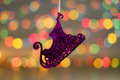 Christmas decorations. Close up photo of New Year purple sled. toy in colorful light