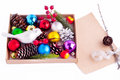 Christmas decorations cones balls berries and paper with fir tree branch Stock Photos
