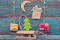Christmas decorations with fir tree, sleigh and gifts Royalty Free Stock Photo