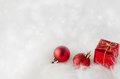 Christmas decorations on fur with sparkling bokeh red ornaments snowy white fake in lower right corner background stars copy space Stock Photography