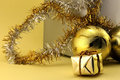 Christmas decorations and gift box two golden baubles gold Royalty Free Stock Photography
