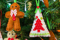 Christmas decorations gingerbread man and x mas tree closeup of handmade Royalty Free Stock Images