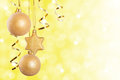 Christmas decorations golden over sparkling background Royalty Free Stock Photo