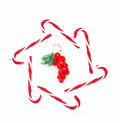 Christmas decorations grape and candy cane Royalty Free Stock Photo