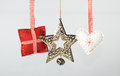 Christmas decorations on gray background made of felt and metal a heart a cusion and a star Stock Image