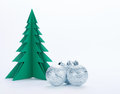 Christmas decorations and green paper tree on a white background Royalty Free Stock Photo