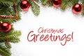Christmas decorations with the greeting `Christmas Greetings!`