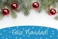 Christmas decorations with the greeting `Feliz Navidad!` in Spanish
