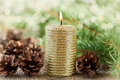 Christmas decorations with lighted candle pine cones and fir branches on wooden background with magic bokeh effect christmas car Stock Images