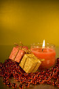Christmas decorations with lit Candle Stock Photos