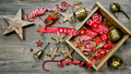 Christmas decorations ornaments and tools vintage style dark on wooden background toned picture Stock Photography