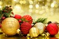Christmas decorations red and gold baubles with twinkling golden background Royalty Free Stock Photos