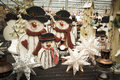 Christmas decorations for sale are arranged on a table Royalty Free Stock Photography
