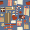 Christmas decorations seamless pattern blue a tile of themed elements and presents arranged to form a ideal for gift wraps Stock Images