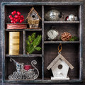 Christmas decorations set: antique clocks, birdhouse, Santa's sleigh and Christmas toys in a vintage wooden box