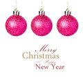 Christmas decorations with shiny red balls hanging isolated on festive white background easy removable sample text Royalty Free Stock Image