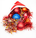Christmas decorations spill out from red santa hat Royalty Free Stock Photo