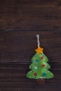 Christmas decorations toy fir tree hanging over wooden background Royalty Free Stock Images