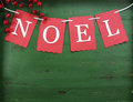 Christmas decorations on vintage green wood background, with Noel bunting. Royalty Free Stock Photo