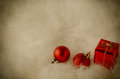 Christmas decorations on white fur vintage red ornaments snowy fake nestled in lower right corner with copy space to the left and Stock Photo