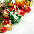 Christmas decorations and xmas tree on white winter snow background Stock Photos