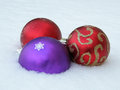 Christmas decorative balls in snow red and violet Royalty Free Stock Photography