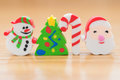 Christmas decorative dolls of snowman fir-tree stick & santa claus Royalty Free Stock Photo