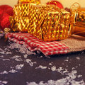 Christmas decorative gift box ball and drum on black background Stock Photography